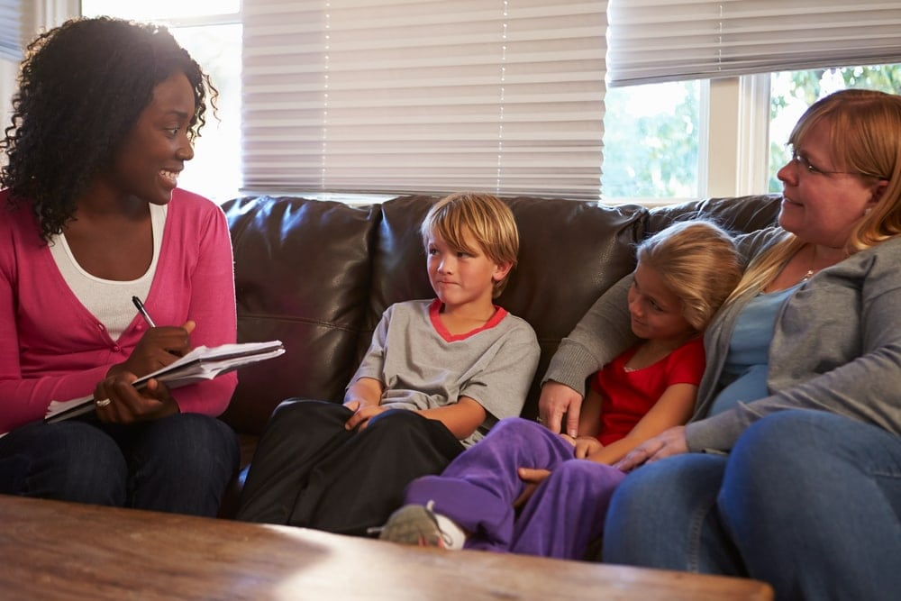 Image of an adoption home study taking place