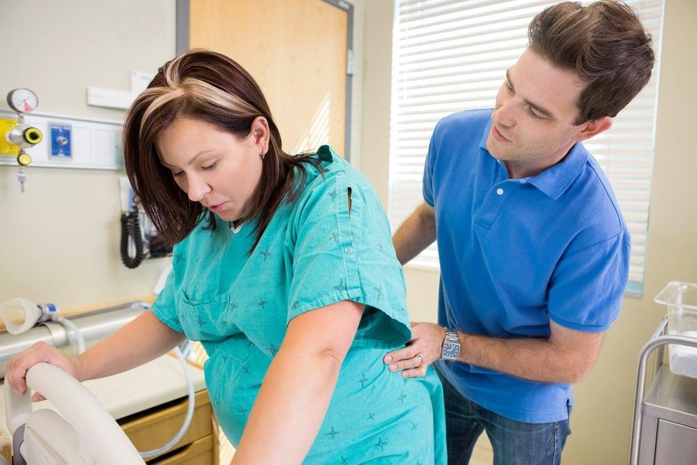 Pregnant woman going through back labor