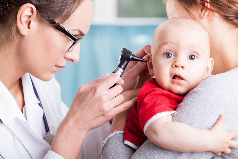 Image of baby with a pediatrician