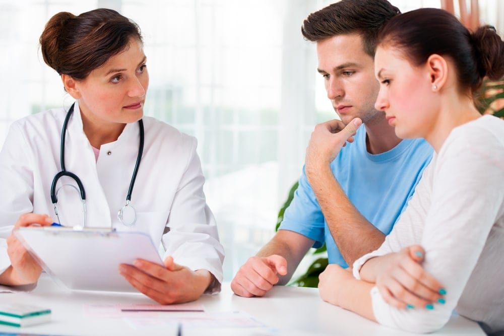 Couple choosing an assisted reproductive technology program