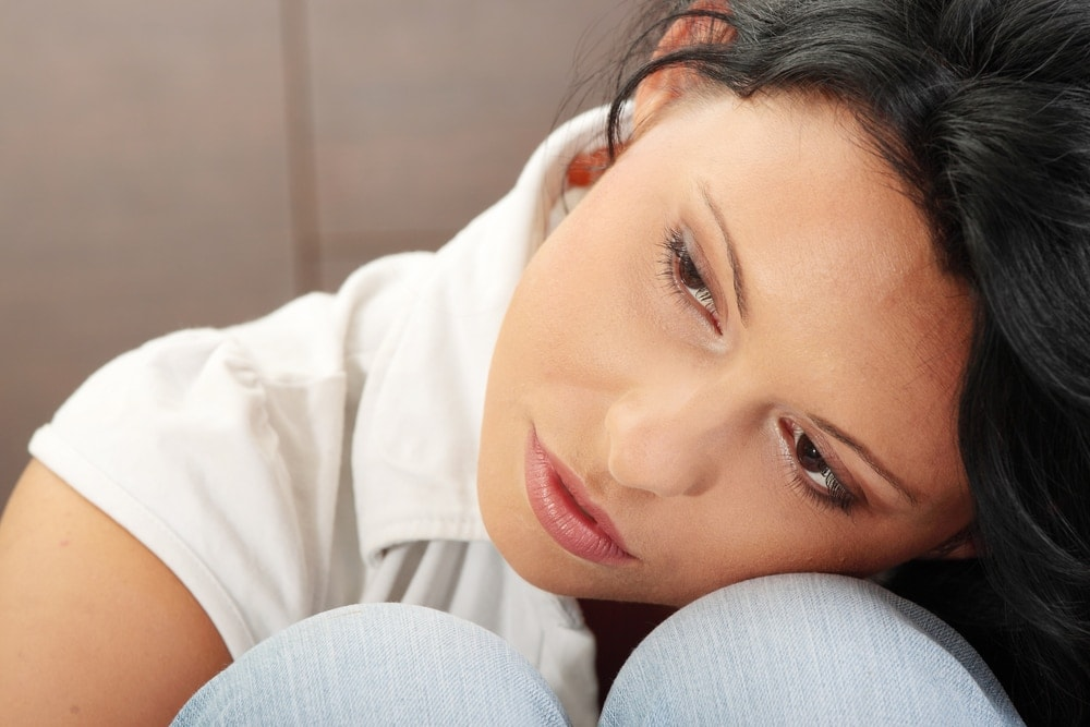 Image of woman depressed about her closed adoption