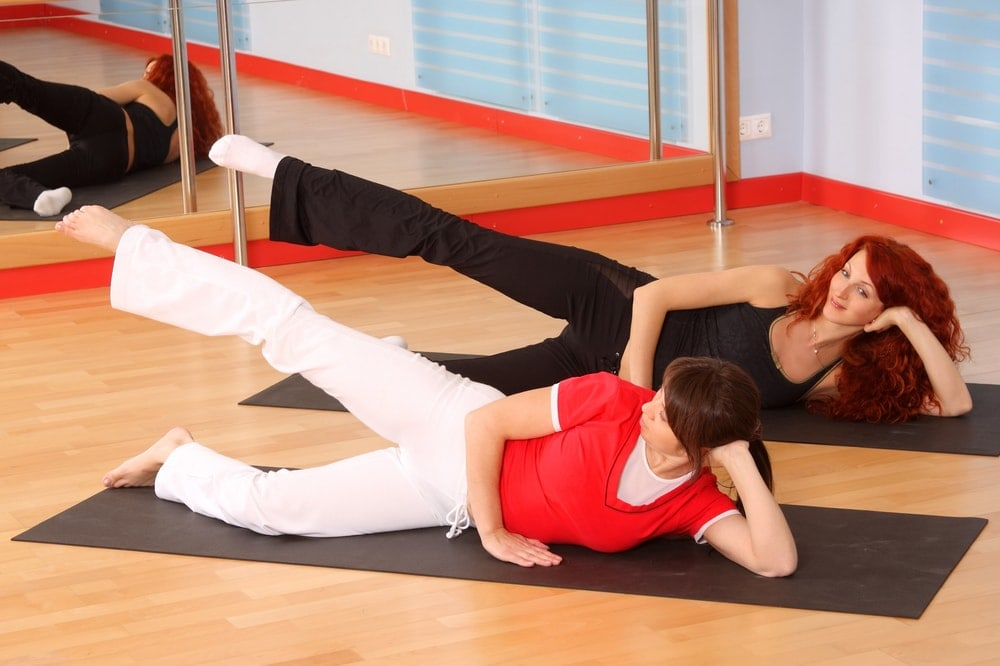 exercise-guidelines-pregnant-woman-stretching-gym | American Pregnancy Association