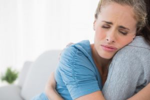 stillbirth-surviving-emotionally-woman-hugging-comforting | American Pregnancy Association