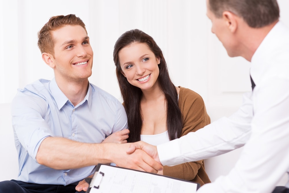 Image of young couple getting financial assistance for their adoption