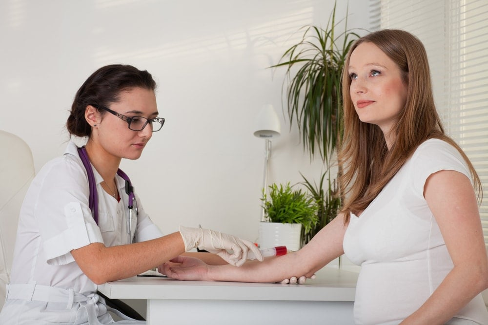 Image of a pregnant woman taking a triple screen test