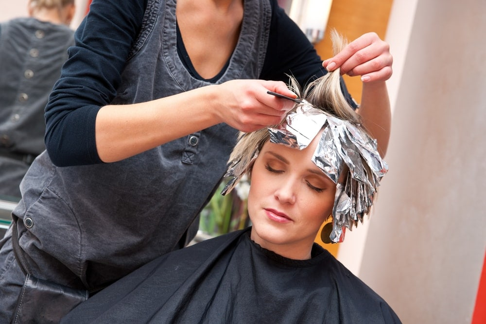 Pregnant woman getting her hair dyed
