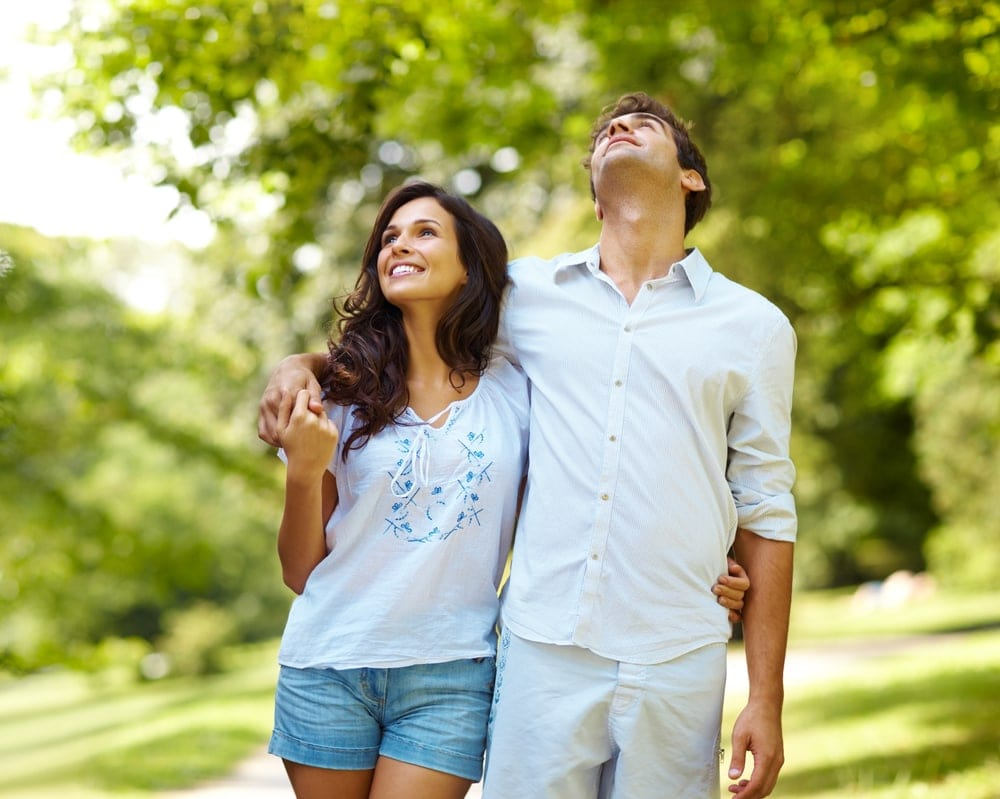 Couple walking thinking about a Pregnancy Insurance Program
