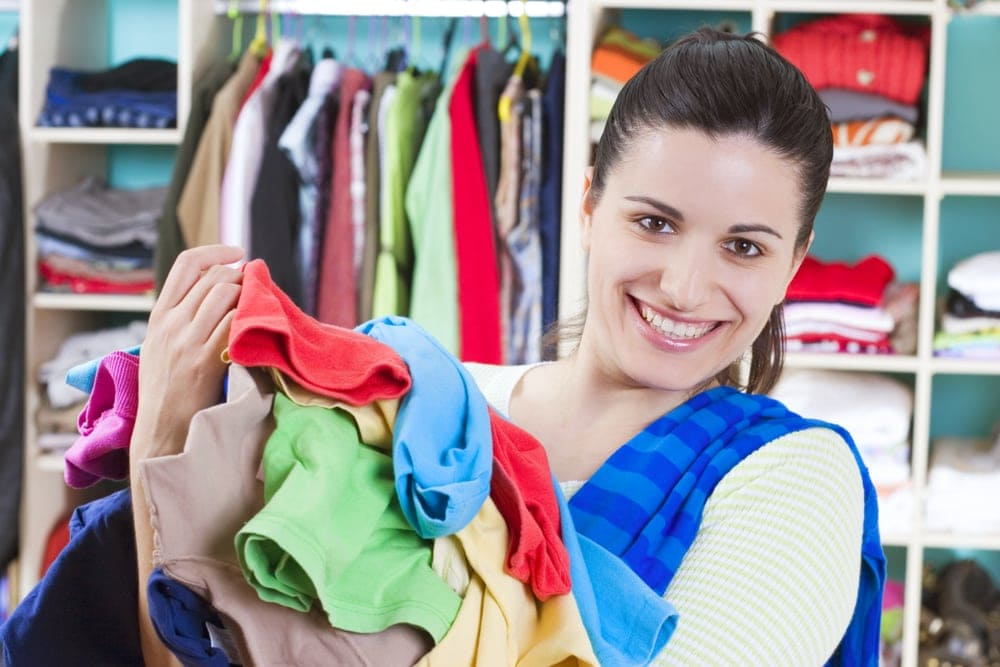 Image of pregnant woman holding laundry