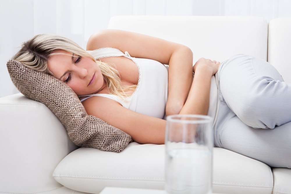 Pregnant woman with an upset stomach because of her diarrhea