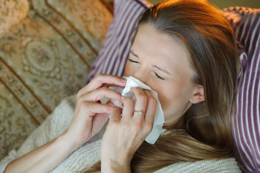 flu-during-pregnancy-pregnant-Woman-blowing-nose-tissue | American Pregnancy Association