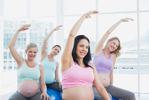 Pregnant woman taking a prenatal class