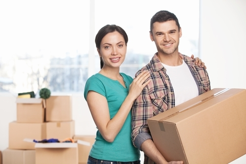 Image of pregnant woman getting help with lifting a package