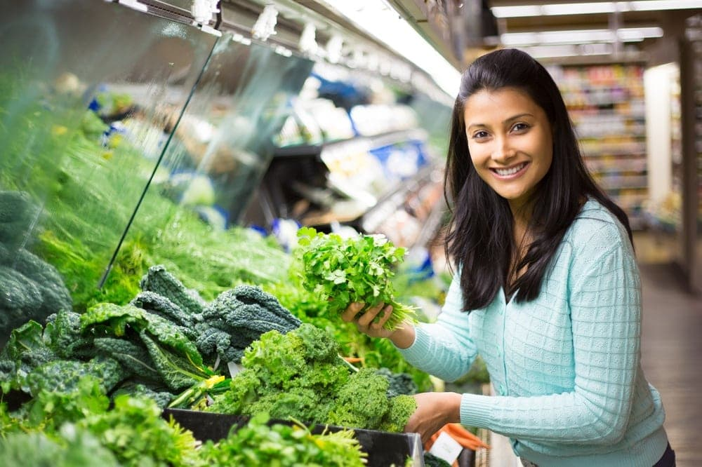 Woman holding some vegetables that are high in calcium