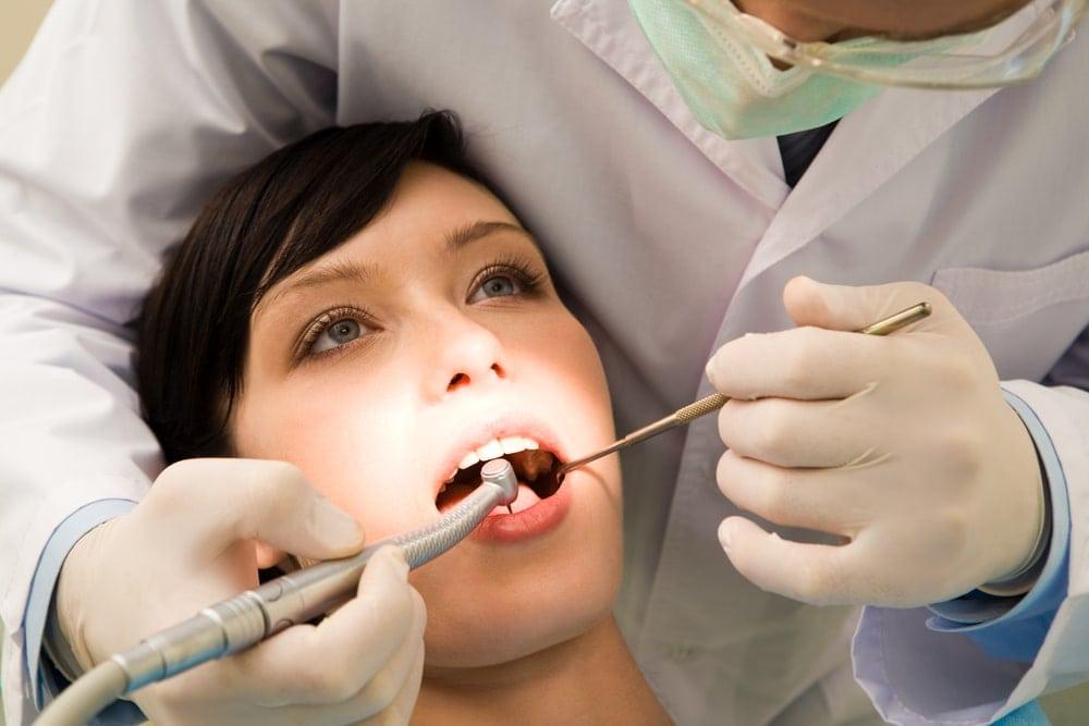 treat-gum-diesease-naturally-during-pregnancy-Pregnant-woman-dentist-drill | American Pregnancy Association