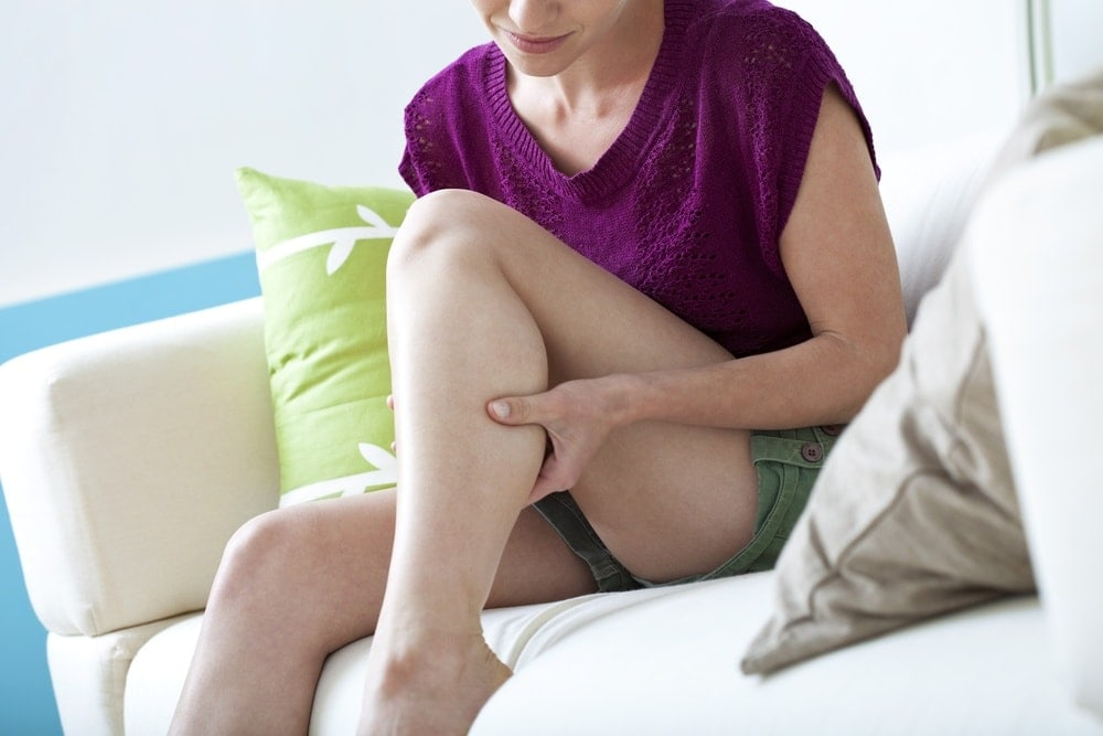 Image of a woman with leg cramp pains during pregnancy