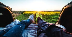 getting-pregnant-after-ovulation-couple-feet-shoes-outside-field-flowers-sunset | American Pregnancy Association