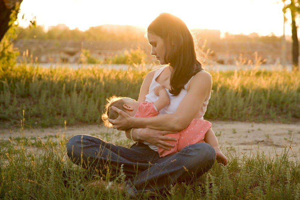 Image of mother with baby preparing to breast pump