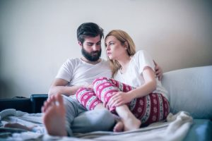 Infertility-101-couple-sad-bedroom | American Pregnancy Association